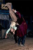 "Stunt performer Heather Woods is thrown through the air by the undead pirate, Captain Cutthroat in the ""Curse of Captain Cutthroat""."